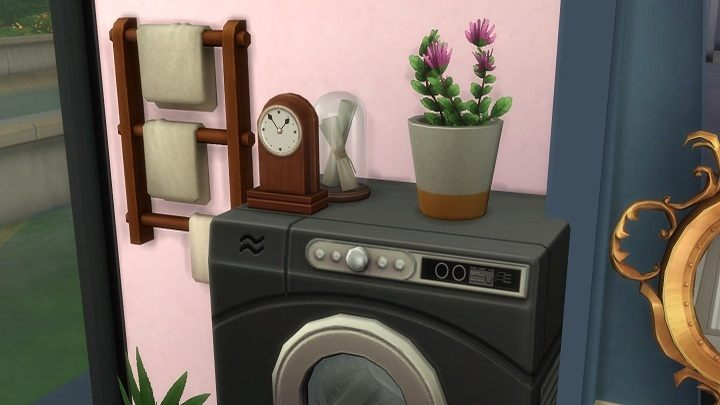 I placed a dryer on top of the washing machine, and then topped it off with a flower pot, a clock, and a glass lampshade – nothing fell, nothing broke. Nothing! That's a simulation of life? If I'd done it irl it would all shatter! - Spending $10 for Laundry in The Sims 4 is My Worst Decision This Year - dokument - 2020-03-09